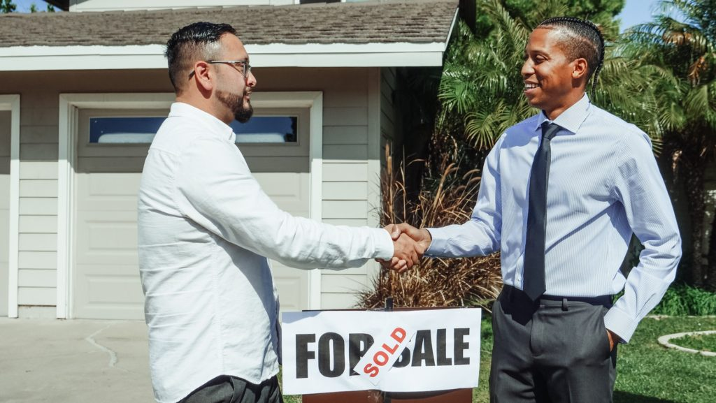Real estate attorney and buyer closing a deal. Real estate failure to disclose lawsuit.